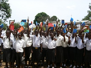 Children in Sierra Leone express their appreciation to Rotary for the gift of new dictionaries.