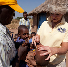 Ann Lee Hussey immunizing a child against polio in Chad.