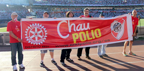 Rotarians in Argentina display an End Polio Now banner at River Plate soccer stadium. Photo courtesy of District 4855