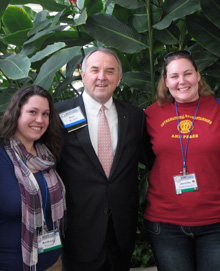 Rotaractors Andrea Tirone, left, and Jennifer Petrichenko, right, with RI President-elect Ron Burton at the Rotary Global Peace Forum in Hawaii.