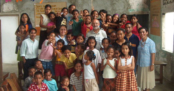 Manuel Cordeiro, center, with primary school children in Timor-Leste. Photo courtesy of Cordeiro