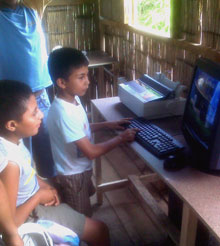 Children in Guayaquil, Ecuador, receive computer training in their new learning center.