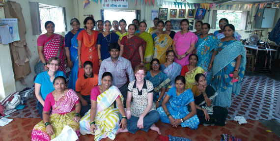 Katrina (left, second row) and Summer (center) in 2009 with members of MarketPlace India, a fair trade textile cooperative based in Mumbai.