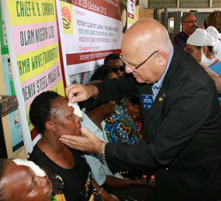 RI Director Gideon Peiper looks at a patient recovering from cataract surgery during an eye camp in Lagos, Nigeria, in October.