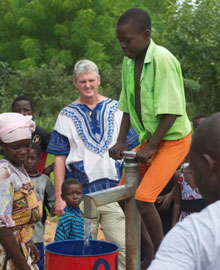 Walter Hughes Jr. watches a water pump in action in South Sudan.