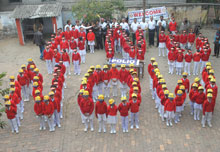Children help spell out End Polio Now during a rally sponsored by the Rotary Club of Bhurkunda.