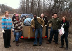 Members of the Rotary Club of Duluth Superior Eco clean up debris along the St. Louis River.