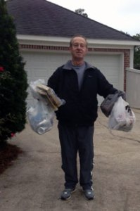 Robin Roberts picks up trash during his daily litter walk.