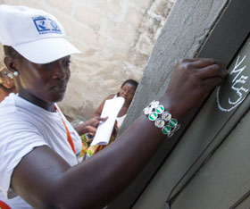 A Rotary volunteer marks a door during National Immunization Days in Côte d'Ivoire. Photo by Alyce Henson/Rotary International