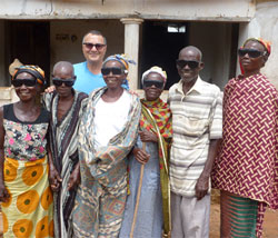 Dr. Albert Alley, director of the World Blindness Outreach, and six villagers who received free cataract surgery during the mission.