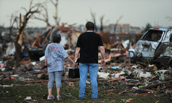 Residents look over the damage in Moore, Oklahoma, USA, after a category 5 tornado touched down 20 May. Photo courtesy Rob Morris