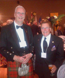 Dr. Robert Scott (in traditional kilt) with Al Brisco, a member of the Rotary Club of Colborne, Ontario, Canada, during the celebration for Scott.