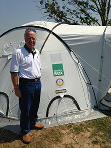 David Shirley with one of the tents ShelterBox deployed for families left homeless by the tornado. Photo coutesy ShelterBox USA