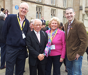 Enda Young, right, with the West Belfast delegation and 2012-13 RI President Sakuji Tanaka at the peace conference in Londonderry-Derry.