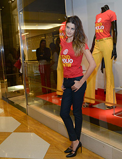 Isabelli Fontana models an End Polio Now T-shirt during the party.