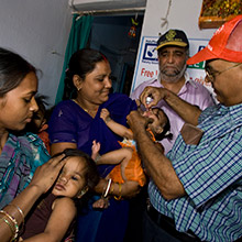 Volunteers immunize a child in India during a National Immunization Day in 2008. Alyce Henson/Rotary International