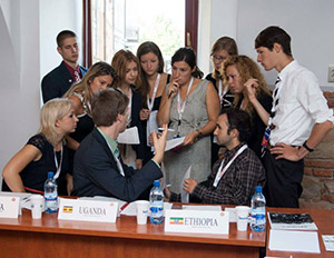 Delegates to the Rotaract Model UN in Romania practice diplomacy.