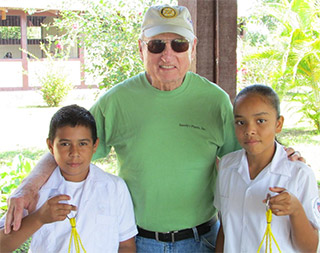 Vince Dooley, former University of Georgia head football coach and athletic director, with children in Honduras during a Rotary service project. Photo courtesy Rotary Club of Atlanta