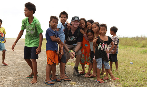 Bill Decker, a Rotary member and ShelterBox Response Team member, with children in the Philippines.
