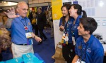 Rotarian John Brodbeck talks to Interactors Katheryn Phan and Alexandra Poh at the Interact booth during the Rotary Convention in Lisbon, Portugal. Monika Lozinska/Rotary International