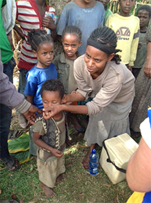 A mother seeks the polio vaccine for her child during immunization activities in southern Ethiopia. Photo courtesy of John Adams