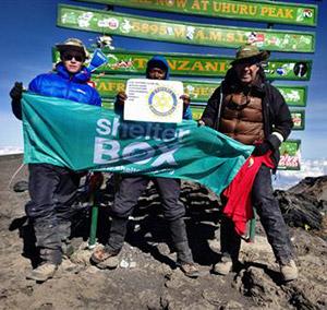 David Johnson (right) and his sons on Uhuru Peak of Mount Kilimanjaro.