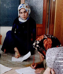 Emine Yuzay writes with her feet, in a photo from the 2006 The Rotarian. Photo by Monika Lozinska