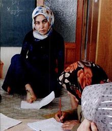 Emine Yuzay writes with her feet, in a photo from the 2006 The Rotarian. Photo by Monika Lozinska