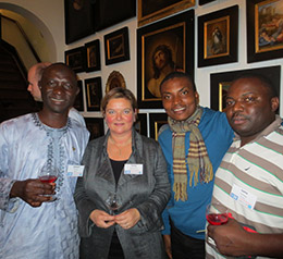 Emmanuel Umolu, with scarf, and his host counselor Tanny Agustinus, second from left, at a welcoming event for the second class of Rotary scholars at UNESCO-IHE.