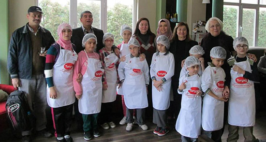 The team that helped put together the cookbook and some of the young test chefs.