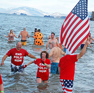 Rotary members in New York jump into the icy waters of Lake George to raise money for polio eradication in January. Photo courtesy Harriet Noble
