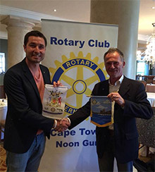 Tzviatko Chiderov exchanges club banners with a member of the Rotary Club of Cape Town Noon Gun,
