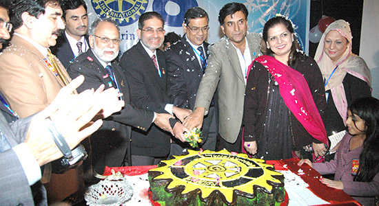 The Rotary Club of Lahore Sharqi, Punjab, Pakistan, celebrates Rotary's anniversary in 2013 with a cake. Photo courtesy of Faheem Asghar