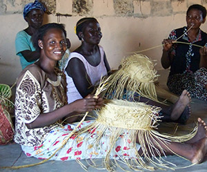 Women weave baskets at a center in Bolgatanga, Ghana. Photo courtesy of Walter Hughes Jr.