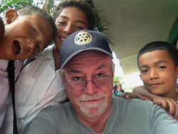 Tennessee Rotarian Charlie Brown with new friends at a school in Honduras.