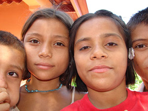 Honduran children. The project is bringing electricity to homes and schools.