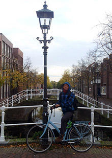 Rotary Scholar Badruz Zaman with his bicycle in Delft, Netherlands.