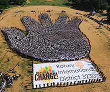 The largest human image of a hand, consisting of 7,084 people.