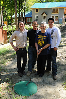 Rotary members helped a father and son in Vermont return to their home following Tropical Storm Irene. Photo by Jon Gilbert Fox, Rotary Club of Hanover, New Hampshire