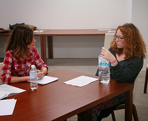 Dimitra Messini, left, discusses mediation with another participant of the workshop.