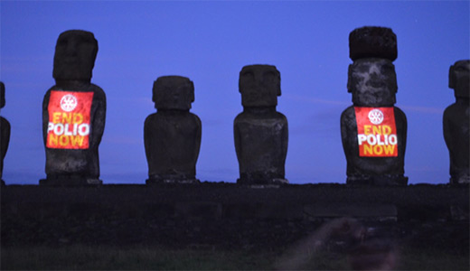 Two moai on Ahu Tongariki illuminated with an End Polio Now message.