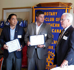 Darren Luong, left, and Matt Pomeroy receive cetifications from District 7090 for their work with youth service.