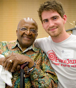 Archbishop Desmond Tutu and Luke Addison at the PeaceJam conference in Winchester, England.