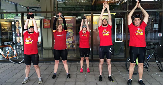 Adam Arents, second from right, leads the Miles to End polio team in a yoga stretch.
