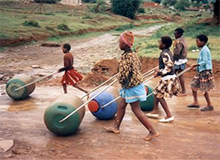 Women use Hippo Water Rollers in Africa to transport clean drinking water.