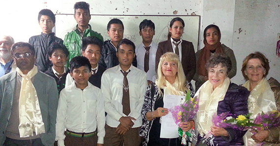 Gail Barlow (third from right) visits with students during a recent trip to a school her Rotary club supports in Nepal.
