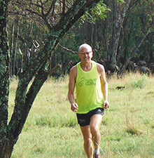 Peter Watson runs in the Savannah Africa wildlife park.