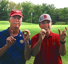 "Jerry Venters (left) and Rger Samuel, members of the Rotary Club of Kansas City Plaza, show the played 100 holes of golf, adding the ""This Close"" gesture."