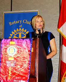 Laureen Harper, wife of Canadian Prime MInister Stephen Harper, addresses Rotary members in Canada during a recent Rotary Day.