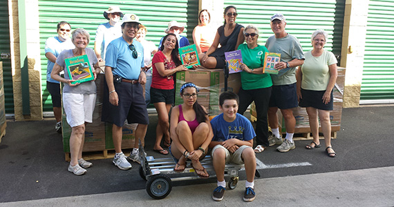 Volunteers from several clubs in Hawaii help collect and store books to ship to the Philippines.